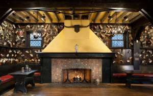 A profile showing the Grille Room's inviting fireplace.